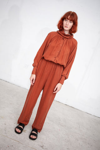 Black Crane Gathered Jumpsuit in Brick | Oroboro Store | New York, NY