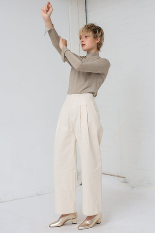 Nomia Pleated Wide Leg Pants in Natural | Oroboro Store | New York, NY