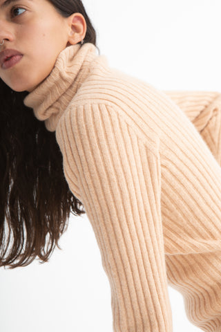 Baserange Simin Turtleneck in Gravel Beige/Rose Side View Close Up of Sleeve, Oroboro Store, New York, NY