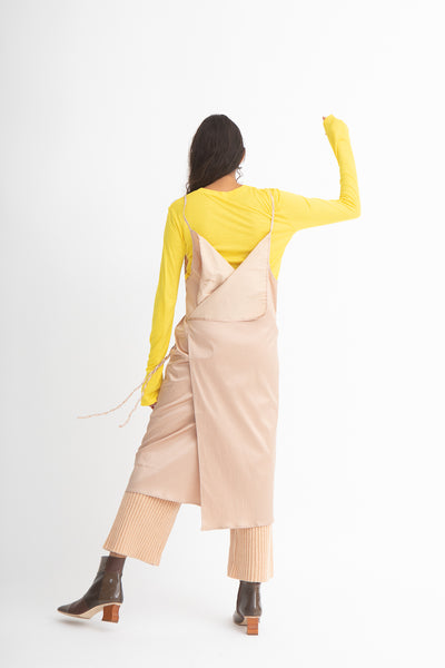 Baserange Yumi Apron Dress in Gravel Beige Back View Full Body