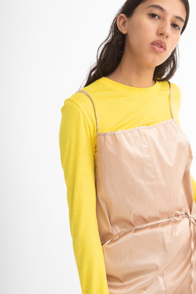 Baserange Yumi Apron Dress in Gravel Beige Front View Close Up