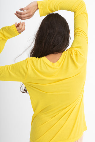 Baserange Long Sleeve Tee in Yellow Back View Arms Over Head, Oroboro Store, New York, NY