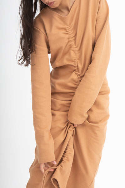Baserange Alsa Dress in Furano Brown Front View Close Up Hands Pulling Up Skirt