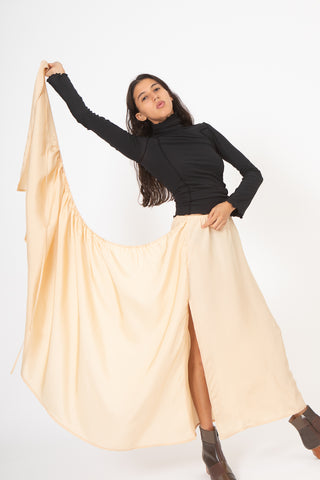Baserange Gada Skirt in Nude Front View Hand Holding Skirt Up, Oroboro Store, New York, NY