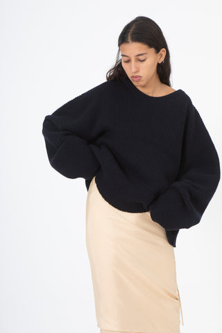 Baserange Kai Sweater in Notte Front View Hands at Waist, Oroboro Store, New York, NY