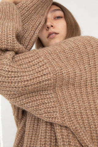 Lauren Manoogian Fisherwoman Pullover in Natural Camel, Side View Hands on Head, Oroboro Store, New York, NY