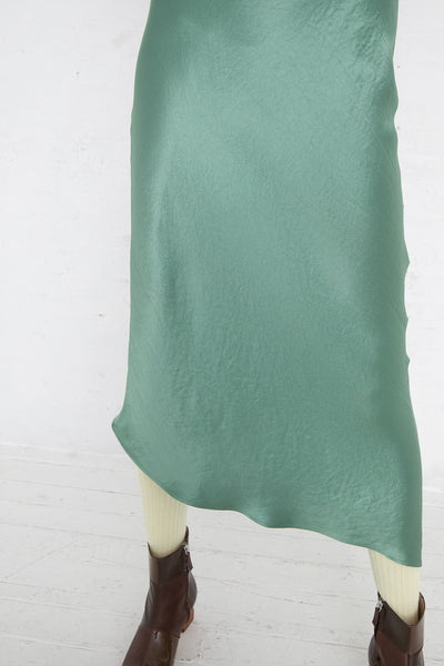 Nomia Cowl Neck Racer Back Dress in Jade, Front View Close Up of Skirt