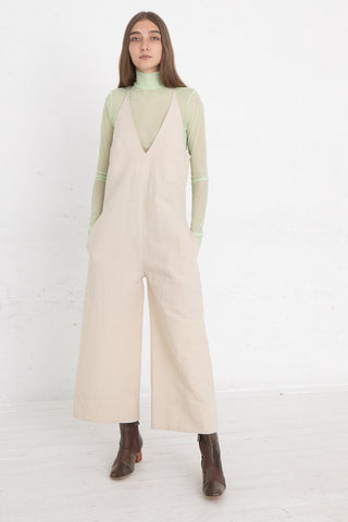 Nomia V-Neck Jumpsuit in Natural, Front View Full Body Hands in Pocket