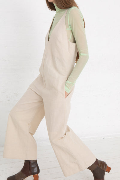 Nomia V-Neck Jumpsuit in Natural, Side View Hand in Pocket