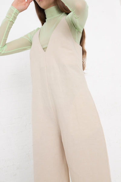 Nomia V-Neck Jumpsuit in Natural, Front View Arms Above Head
