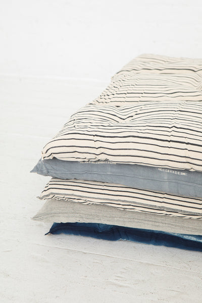 Tensira Mattress/Bedroll in Kapok in Grey Tye & Dye, Group Shot Close Up of Corner