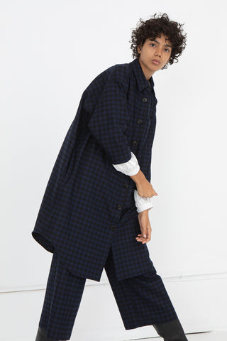 AVN Shirtdress in Blue and Black, Side View Hand on Opposite Cuff, Oroboro Store, New York, NY