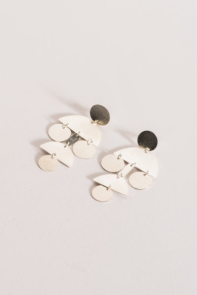 Annie Costello Brown Mini Pom Pom Earrings in Sterling Silver | Oroboro Store | New York, NY