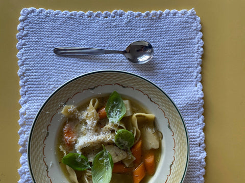 A bowl full of pappardelle with carrots and parsnips