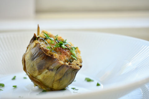 Pan roasted artichoke flower served on a plate
