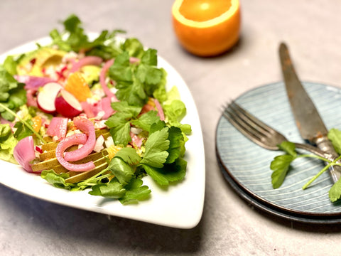 A serving tray with a pear, avocado and chili salad