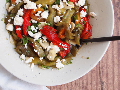 A bowl with a bell pepper and feta salad