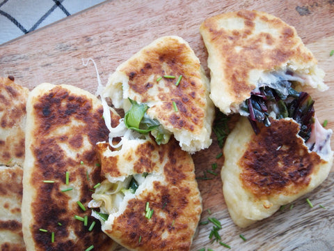 Some opened potato pockets with leek and chard filling