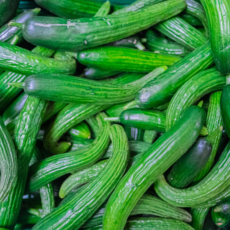 Image of a bunch of cucumbers in different shapes