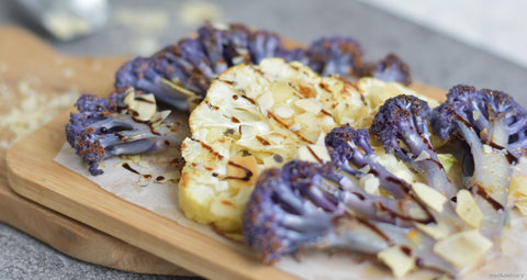 roasted cauliflower steaks with almond flakes