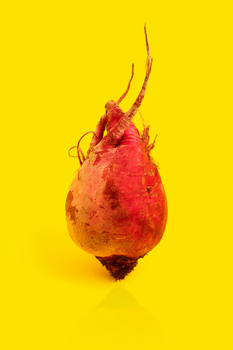 A picture of an upside down turnip on a yellow background.