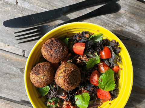 Bowl with quinoa salate, falafel and cabbage