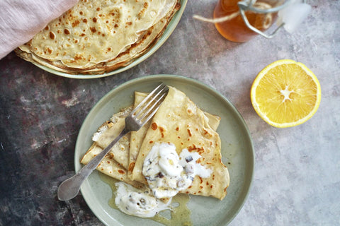 crepes with orange sirup on a plate