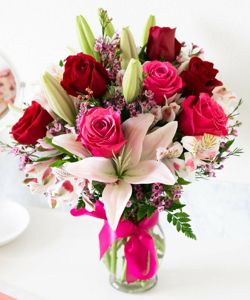 Blooms of Roses & Lilies (Free delivery)