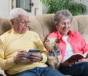 retired couple with their small dog
