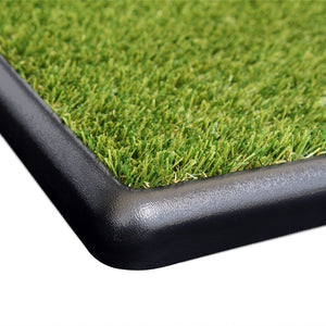 Grass sits flush with the top of the tray