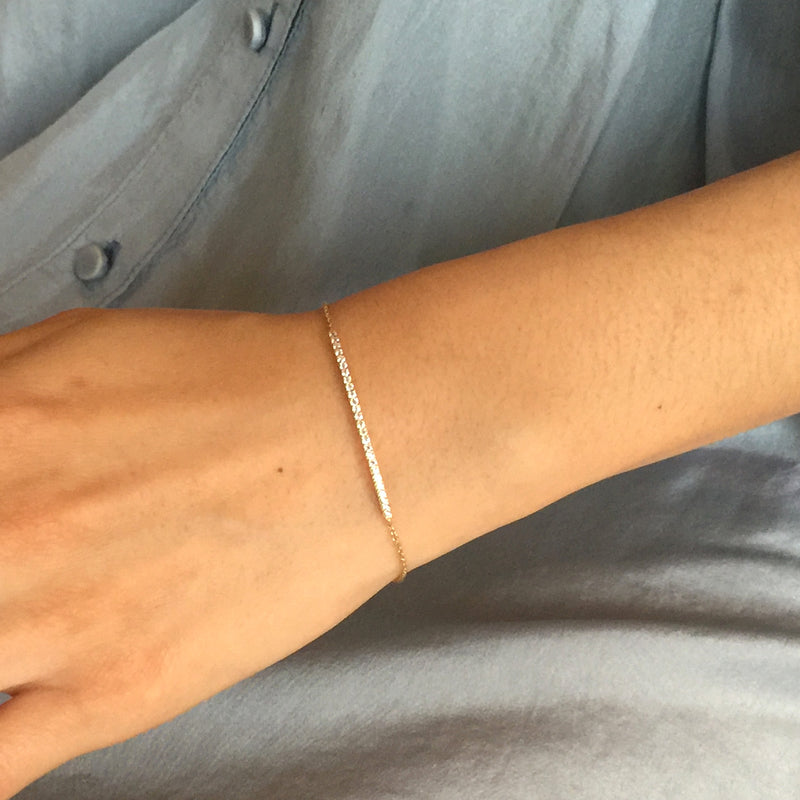 Wrist wearing Curved Bar with CZ gold Bracelet