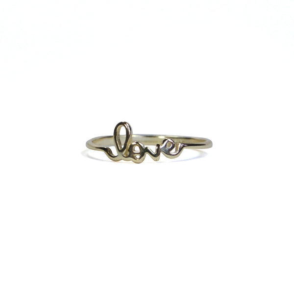Yellow gold lover letter ring at an alternate angle