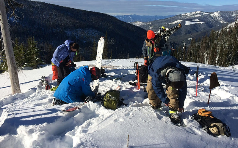 backcountry skiing group putting on ski gear