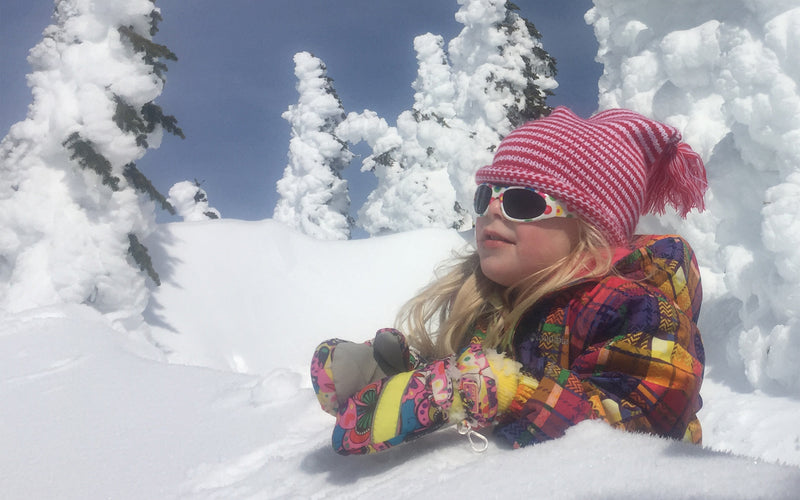 little girl in snow cover trees