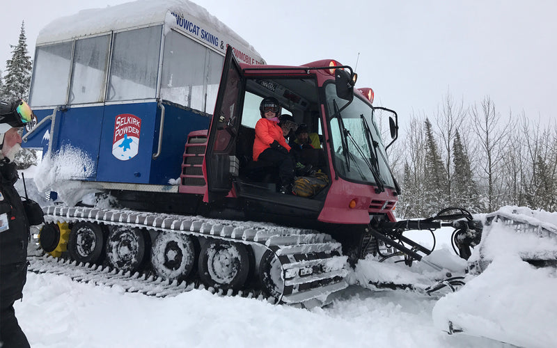 kids in a snowcat