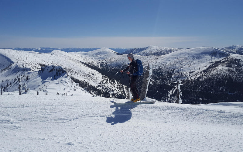 backcountry skier on mountain ridge