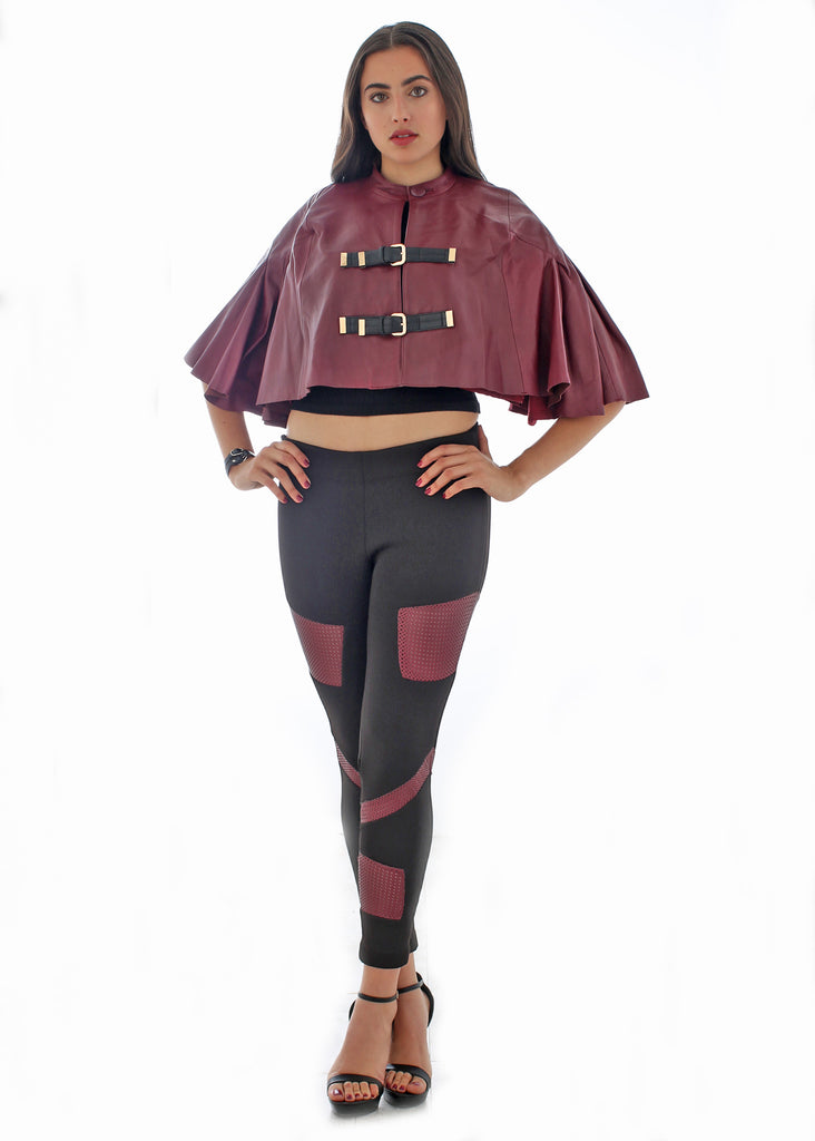 Leather buckled cape with pleated sleeves