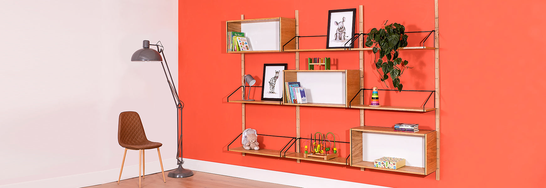 six oak Forma shelves and three oak Formadisplay boxes on adjustable modular shelving system