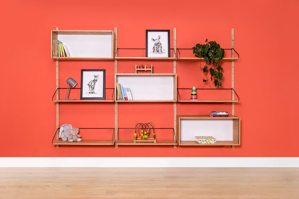 six oak Forma shelves and a three oak Forma display boxes on adjustable modular shelving system