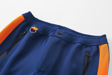 Load image into Gallery viewer, Track Pants in navy/orange