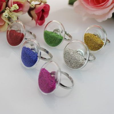 COLORFUL FLAT RING IN GLASS CASING