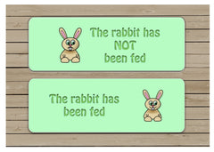 The rabbit has been fed reversible hanging pet sign.