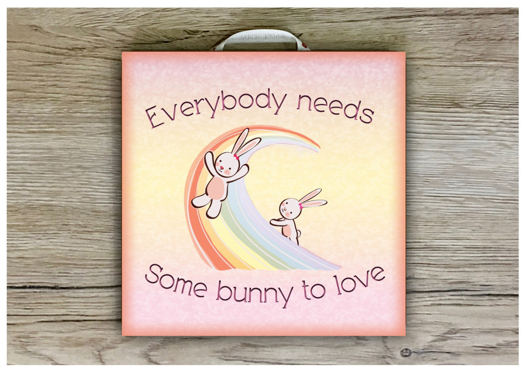 Everybody needs some bunny to love quote or add your own text to our metal or wood sign.  Handmade at www.honeymellow.com