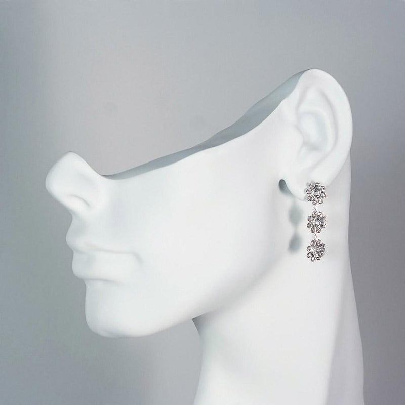 rhinestone drop earrings on mannequin