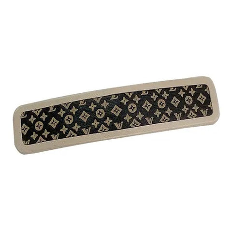 black leather LV hair clip