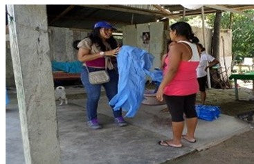 Peruvian women with an Insect Shield bug repellent blanket.