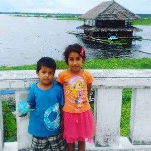 Young residents of Peruvian region devastated by flooding.