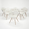 Molded Plastic Armchairs by Charles & Ray Eames sold by the modern archive