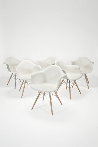 Molded Plastic Armchairs with Dowel Base <br/>by Charles & Ray Eames