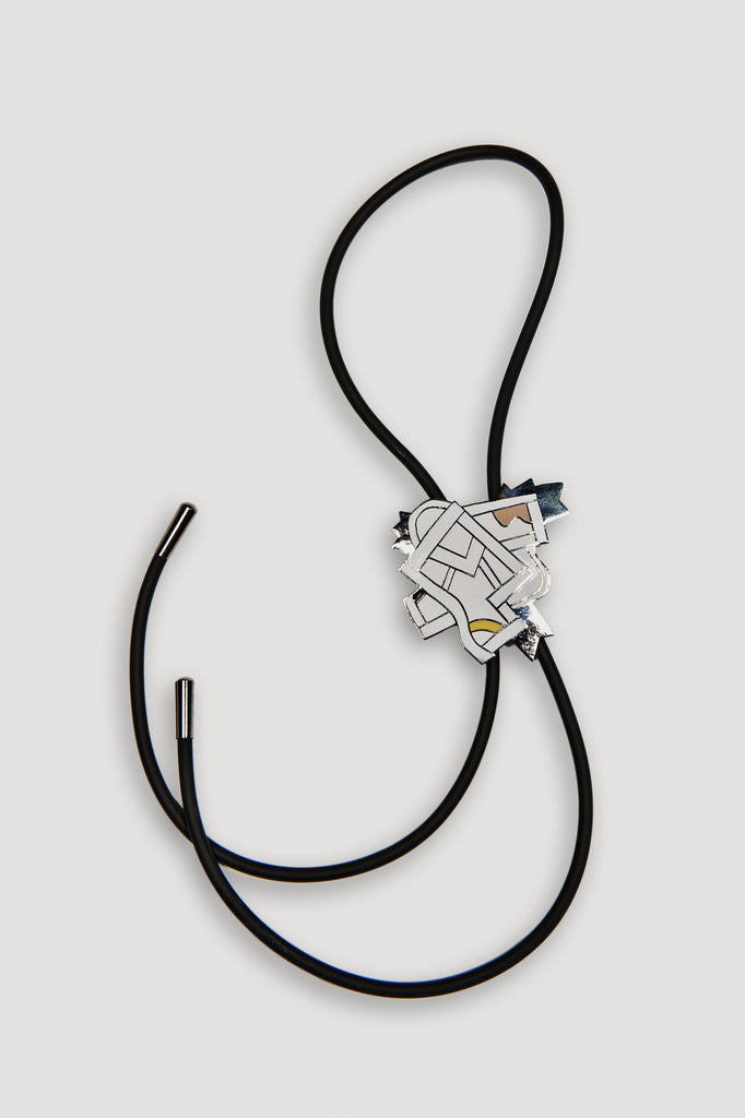 Futura Bolo Tie by Ettore Sottsass for Acme Studios sold by the modern archive